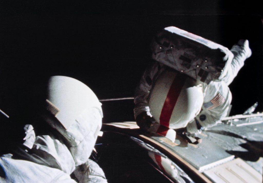 Ken Mattingly (red stripe) during his EVA on Apollo 16.