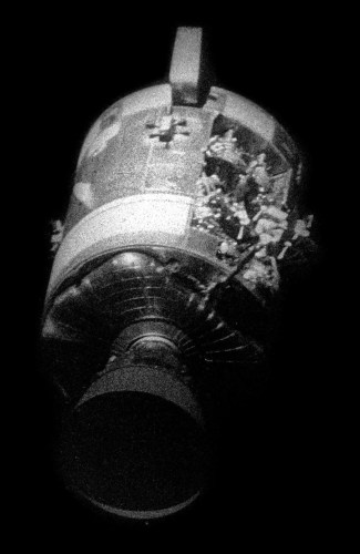 Apollo 13 Service Module after separation showing the damage from the oxygen tank explosion.