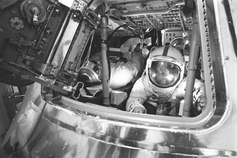 Ken Mattingly (right) in the Command Module