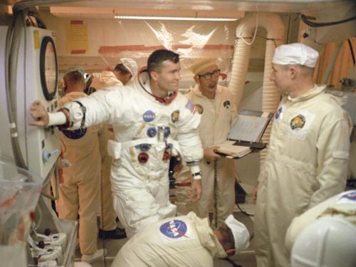 Apollo 13 lunar module pilot Fred Haise chats with Guenter Wendt and other members of the pad closeout crew in the White Room following a countdown demonstration at Launch Complex 39A.