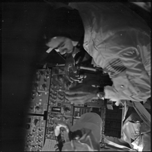 Astronaut Fred Haise in the Command Module.