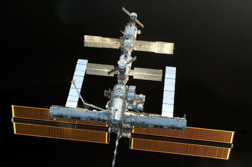 The International Space Station (ISS) as seen by Space Shuttle Discovery STS-114 .