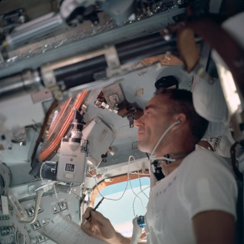 Walt Cunningham inside the Command Module during Apollo 7