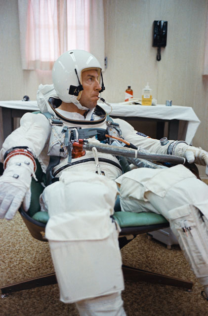 Jim Lovell has a temperature check with an oral temperature probe attached to his spacesuit during a final preflight preparations for the Gemini 7. The temperature probe allows doctors to monitor astronauts' body temperature at any time during the mission. Photo credit: NASA
