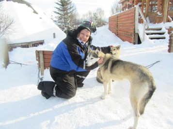 Sam with Huskies. Only another 298 to pet.