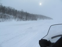 Snowmobiling on a frozen part of the Barents sea