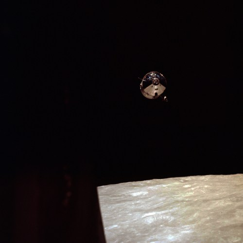 Command Module Charlie Brown in lunar orbit as seen from the LM Snoopy