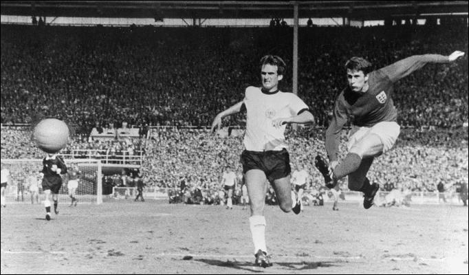 Sir Geoff Hurst scoring for England against West Germany in the 1966 World Cup final