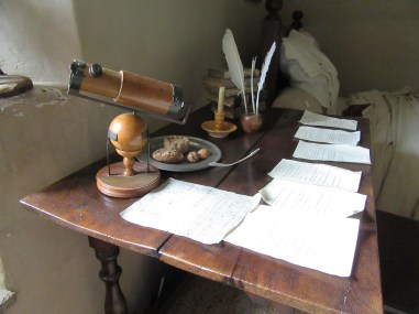 Newton's desk and a model of his reflecting telescope