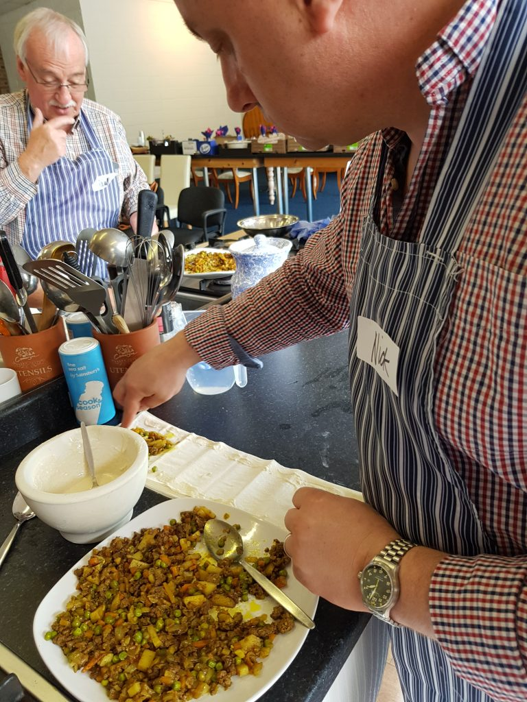 Nick making lamb samosa at Indian takeaway cookery class