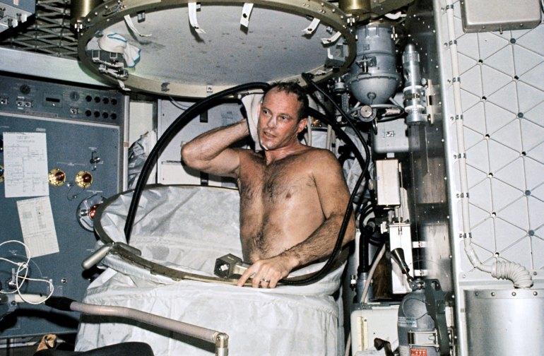 Jack Lousma showers aboard Skylab
