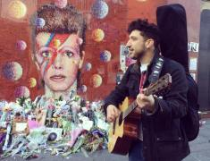 Nick-Stephenson-singing-near-David Bowie Mural
