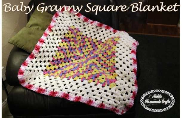 Crocheted Pink, yellow, purple and white Baby Granny Square Blanket
