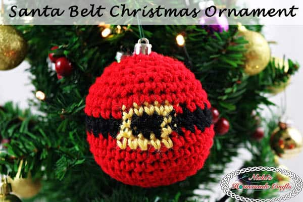 Santa Belt Christmas Ornament - hanging ornament on the Christmas Tree with lights showing off its name on the top - Free Crochet Pattern by Nicki's Homemade Crafts #crochet #ornament #christmas #winter #tree #free #crochet #pattern #belt
