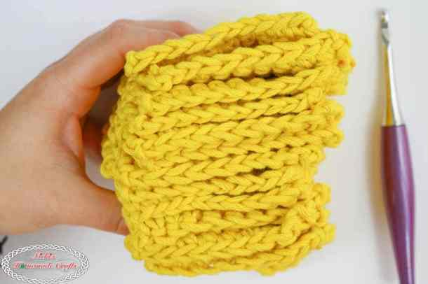 Mystery Crochet Along part 1 yellow squares stack in hand