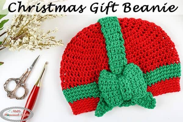 Christmas Gift beanie with flowers, crochet hook and scissors