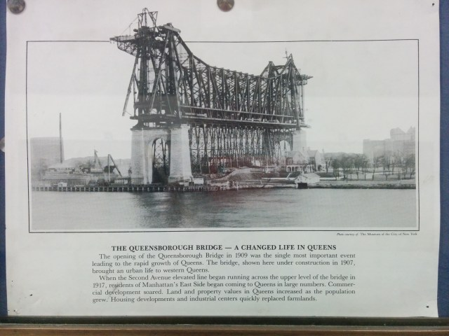 The opening of the Queensborough Bridge in 1909 was the single most important event leading to the rapid growth of Queens. The bridge, shown here under construction in 1907, brought an urban life to western Queens. When the Second Avenue elevated line began running across the upper level of the bridge in 1917, residents of Manhattan's East Side began coming to Queens in large numbers. Commercial development soared. Land and property values in Queens increased as the population grew. Housing developments and industrial centers quickly replaced farmlands.