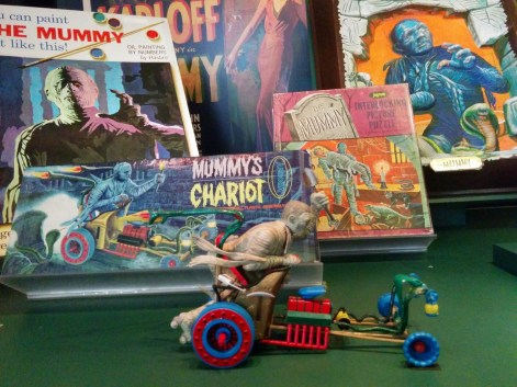Mummy collection: chariot, 1964; puzzle, 1960s; wall plaque, 1960s