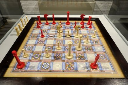 Antique Handpainted Chessboard, late 19th c. with Northern Upright Tall Ivory Set, 1830