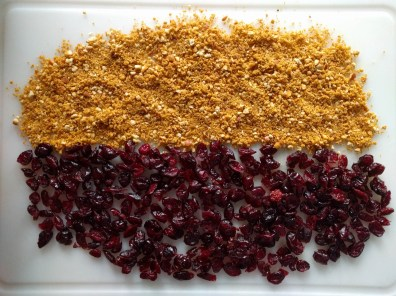 cranberries and crushed jalapeño pretzel for a cheeseball shell