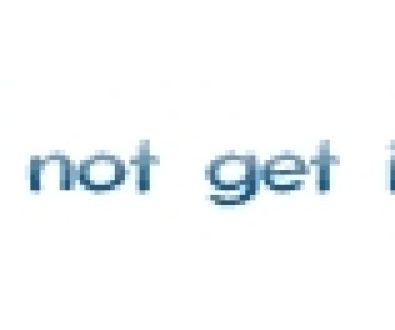 a man with drilling rigs behind him in the distance.