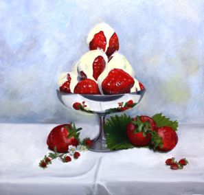 Strawberries and cream and wild strawberries with a silver dish