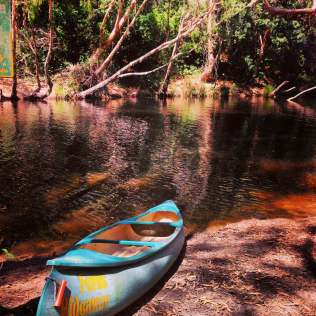 An image of a kayak by the creek at Ferns Hideaway Holiday Park, Byfield, Australia