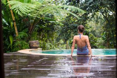 Me sat by our plunge pool at Sandat Glamping Resort Ubud.