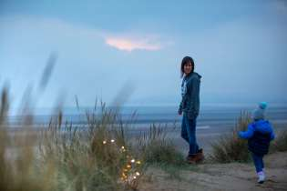 An image of me standing admiring the views from the sand dunes on the beach at Camber Sands
