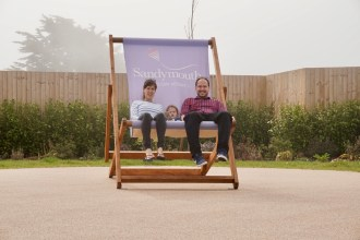 Sat on a giant deckchair with Matt and Emily at Sandymouth Holiday Park, Bude, Cornwall.