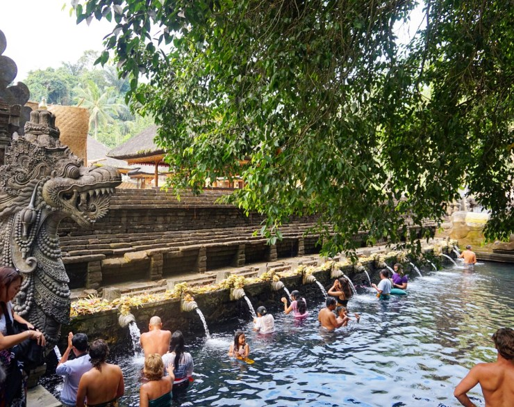 People bathing in the holy water at Tirta Empul, Bali.