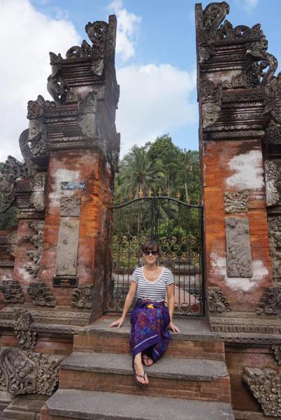 Myself sat in between a Balinese doorway at Tirta Empul, Bali.