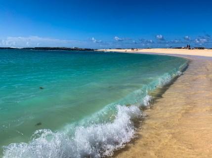 Waves rolling onto the shore at La Concha Beach, El Cotillo, Fuerteventura