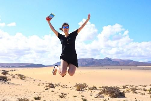 Jumping in the sand dunes in Corralejo, Fuerteventura