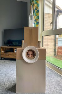 Emily in her cardboard rocket - one of my favourite things to do with kids during lockdown