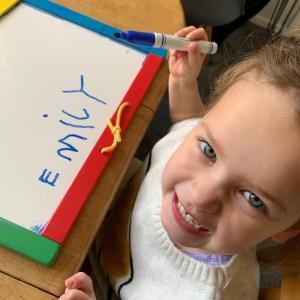 Emily writing her name during lockdown 2020