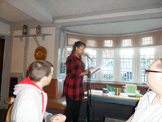 Me reading out my poetry at the Britannia Inn Poetry Open Mic