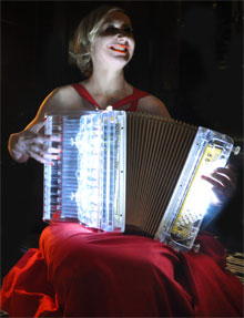 Nicole Renaud and her lit-from-within accordion, cool.