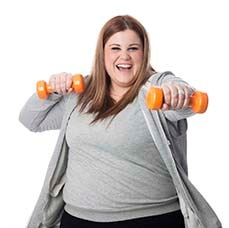 A woman exercising with small dumbbells in her hands