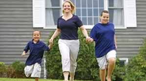 Mother and kids skipping