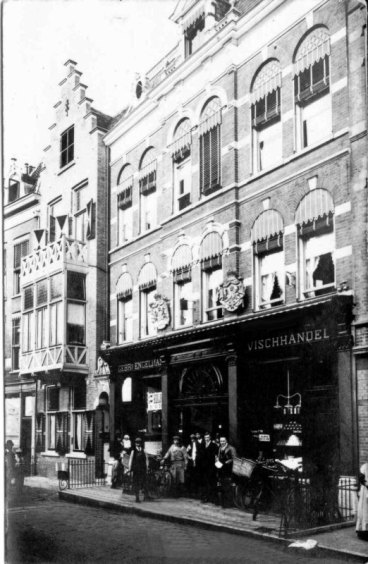 Proud Engelmen and their staff in front of Vismarkt 13. Photo: private archive