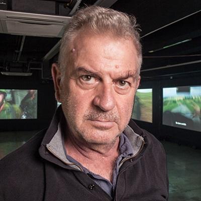 headshot photo of Avi Mograbi by Jose Kattan