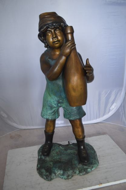 "Boy holding a bottle water fountain -  Size: 17""L x 14""W x 38""H."