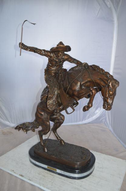 "Jumbo Bronco Buster  by Remington Bronze Statue -  Size: 19""L x 11""W x 36""H."