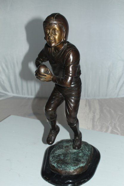 "Boy playing football Bronze Statue -  Size: 10""L x 8""W x 20""H."