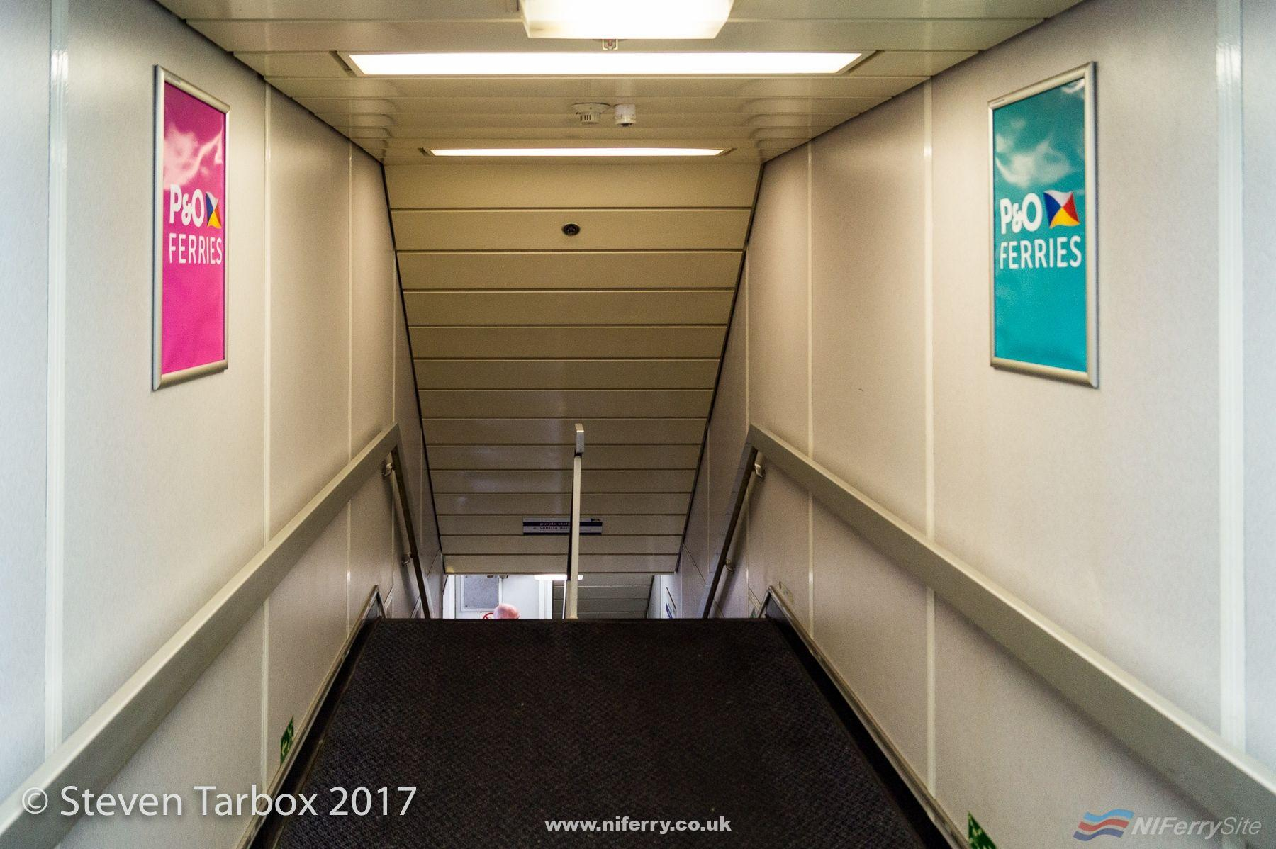 The main stairs between deck 5 and 4. Some of the signage showed signs of the P&O Stena past of the vessel. This example was on the vehicle deck. © Steven Tarbox