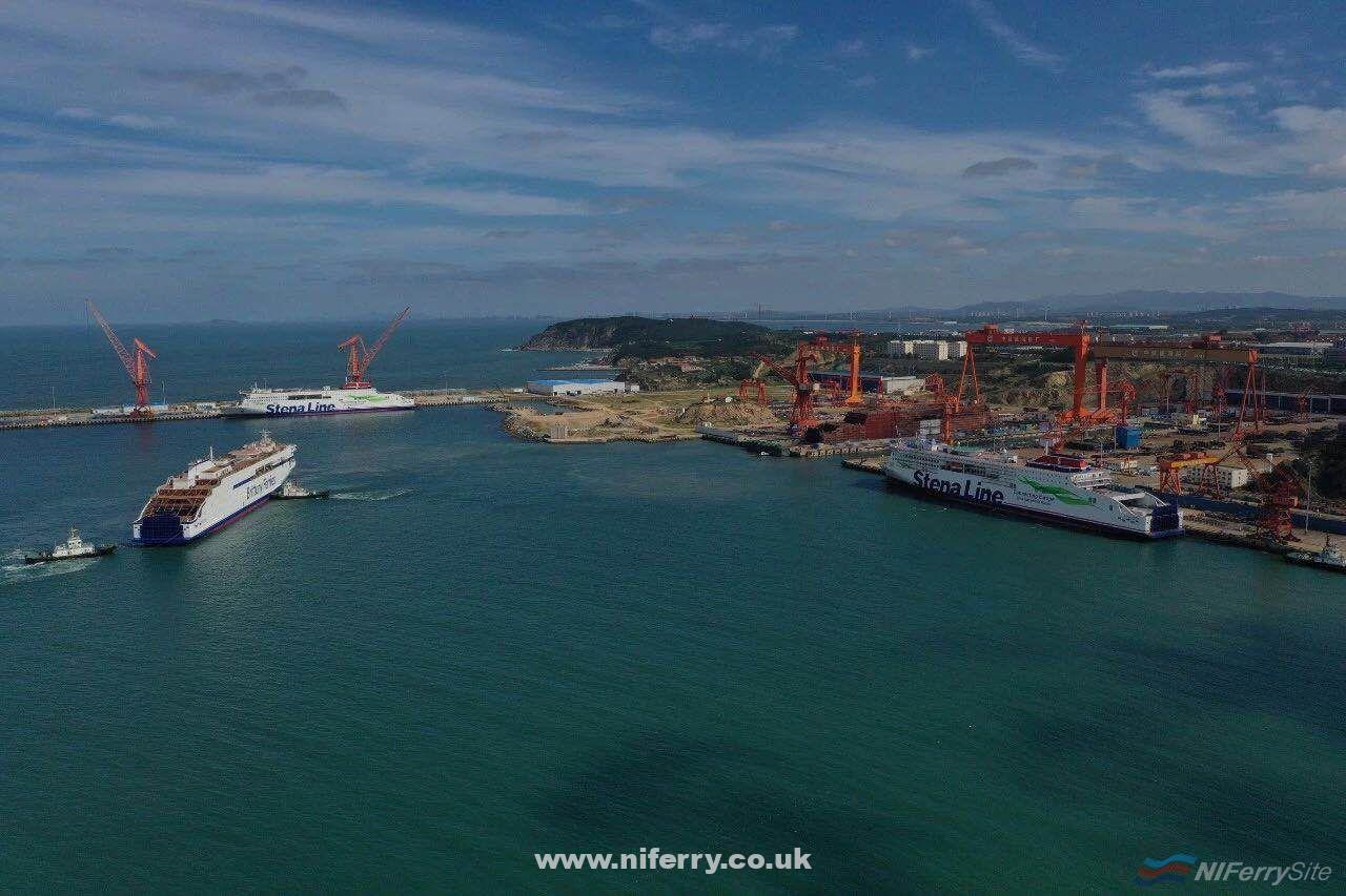 GALICIA (left) is manoeuvred into position by tugs after leaving her building dock, 11.09.19. In the background is STENA ESTRID which is in the advanced stages of fitting out, while STENA EDDA is seen during fitting out to the right of the picture. The vessel under construction just ahead of STENA EDDA is her sister-ship and operating partner for the Belfast to Liverpool route STENA EMBLA. Courtesy of Stena RoRo.