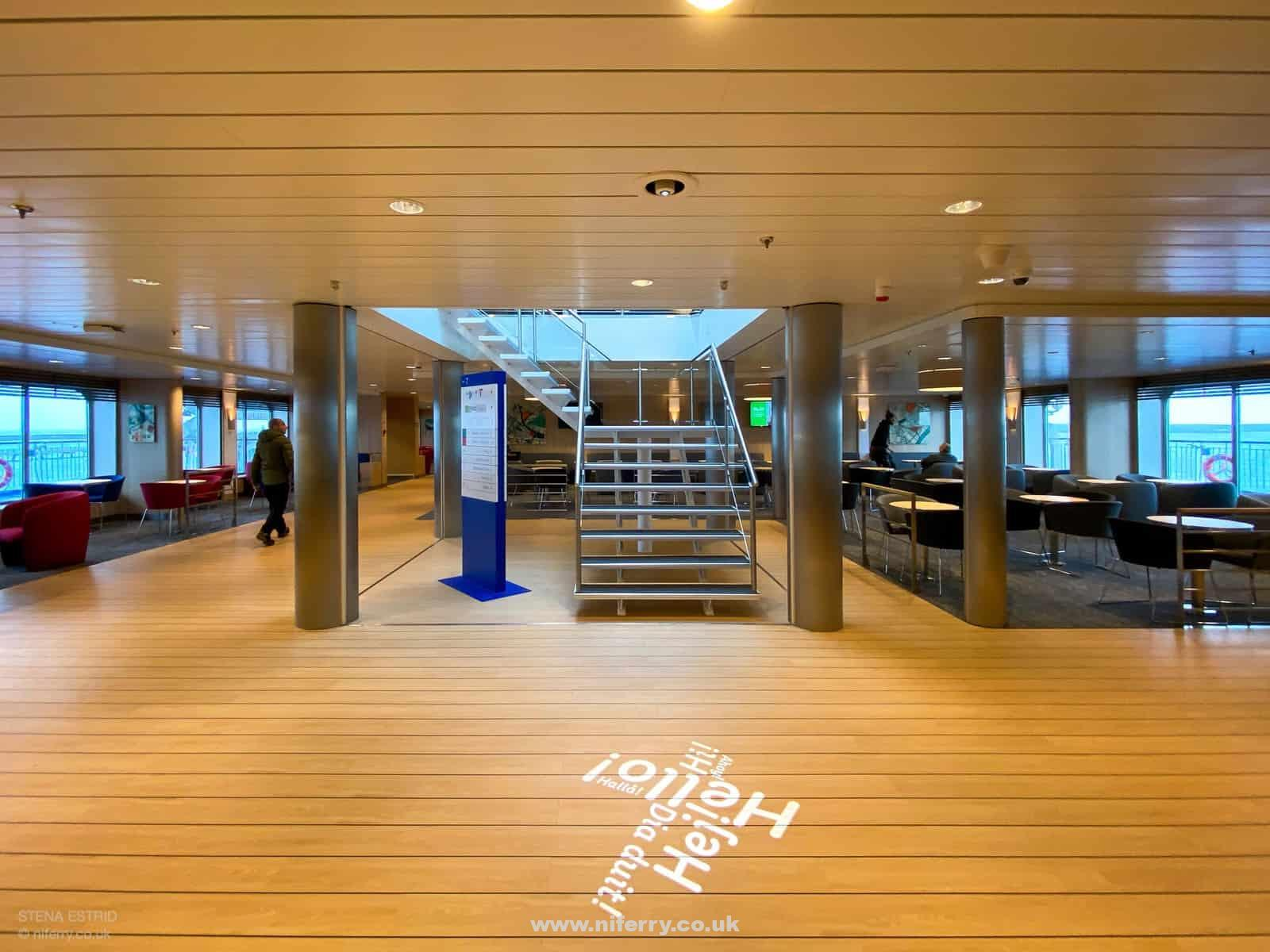 Lobby area in front of Guest Services looking towards the staircase to Deck 8's 'Sky Bar'. Again, a message is projected onto the floor from the deckhead above. © NIferry.co.uk