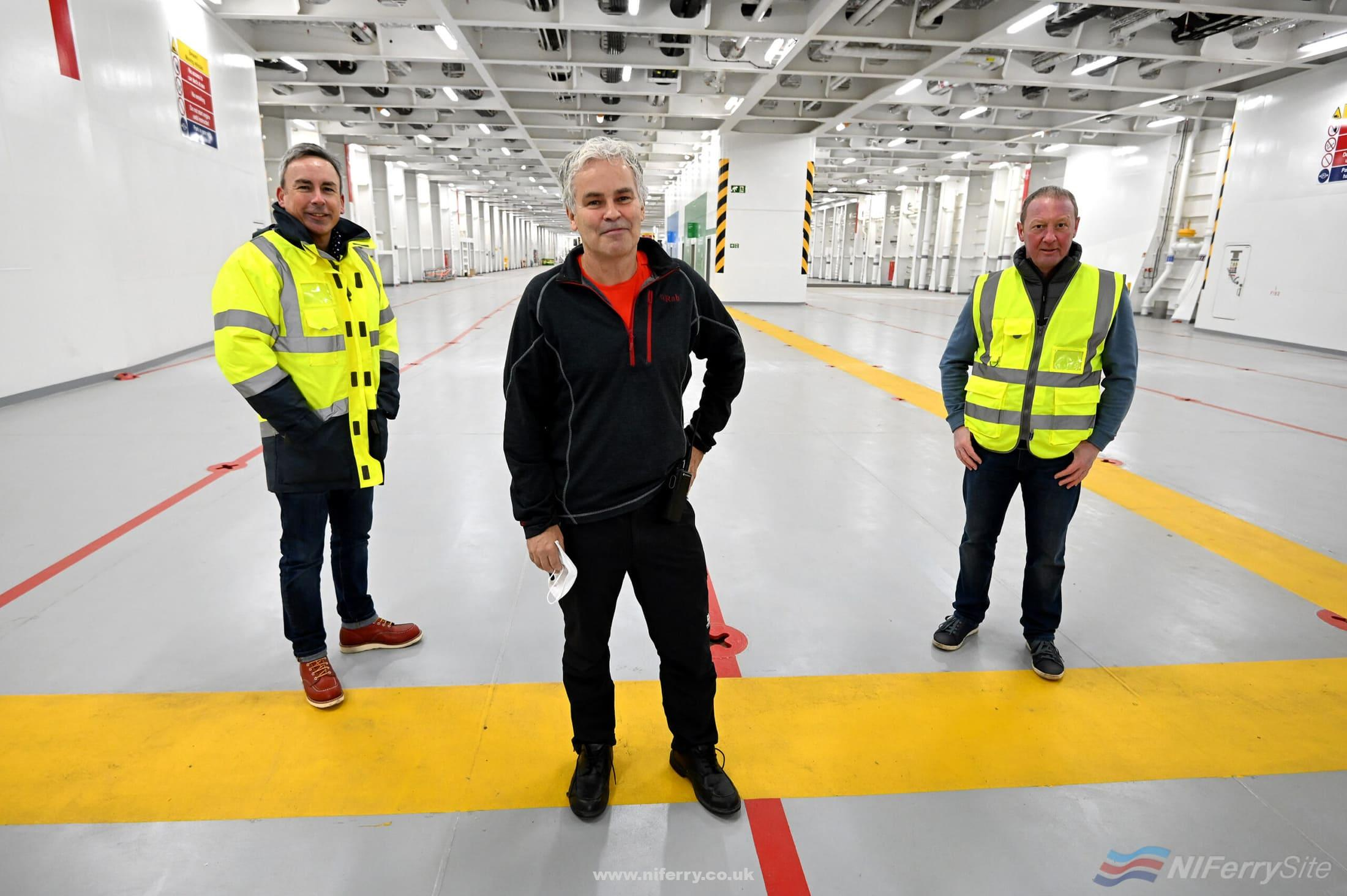 Paul Grant (Trade Director Irish Sea), Captain Neil Whittaker (Senior Master - Stena Embla), and Howard Hillis (Operations Manager) on the vehicle deck of STENA EMBLA. Stena Line.