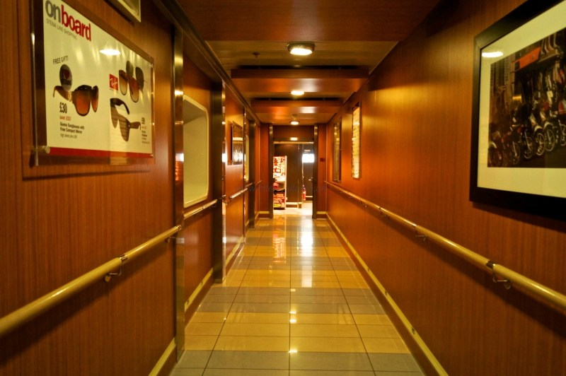 Link corridor between the rear an front areas of passenger accommodation. This picture is taken looking towards the stern of the ship and so the passenger cabins on this deck are behind the panelling on the right. © Niferrysite